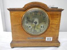 A mahogany mantel clock with key (springs ok).