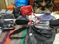 A mixed lot of hand bags including vintage.