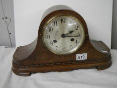 A mahogany mantel clock in working order.