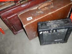 A small vintage suitcases a leather briefcase & an amplifier