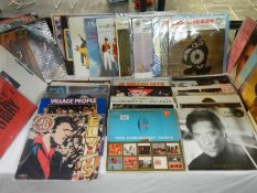 A mixed lot of LP records including Elvis Presley, Tom Jones, Village People, Hot Chocolate,