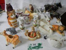 22 ceramic items including bisque swans, candlesticks etc.