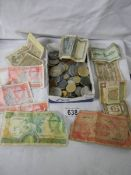 A mixed lot of old coins and bank notes.