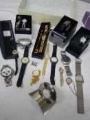 A good lot of Ladies and Gents watches including a 2 piece clock.