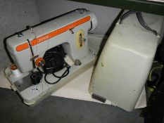 A cased Jones electric sewing machine.