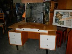 A dressing table with triple mirror, in good condition.