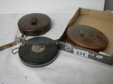 3 vintage tape measures.