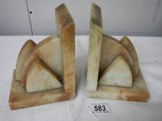 A pair of marble book ends in good condition,.
