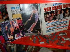 In excess of 40 mainly 70's and 80's LP's, a selection of 45 rpm records and some toy soldiers.