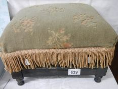 An Edwardian footstool in good condition, no damage to spindles.