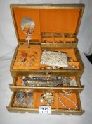 A jewellery box and jewellery including silver chain.