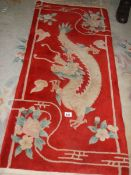 A dragon patterned Chinese rug.