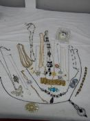 A good mixed lot of costume jewellery including a glass clock, 25 items.