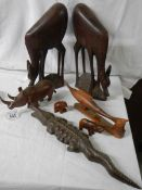 A mixed lot of wooden items including 45 cm long crocodile and 36 cm tall antelope.