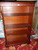 A mahogany book case.