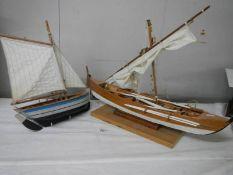 2 good model sailing boats, small 33 cm long, large 62 cm long.