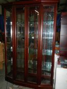 A superb quality glazed cabinet with etched glass doors.
