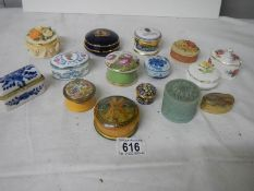 A mixed lot of interesting ceramic and wood trinket/pill boxes.