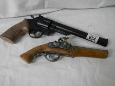 Two wall decoration pistols.