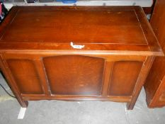An oak and ply panelled blanket box.