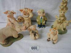 7 assorted pig figures.