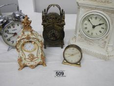 A small lot of assorted mantel clocks including brass lantern clock (bell present but not fitted).