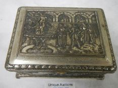 An embossed silver plated box decorated with Elizabethan dancers in a court yard, plate worn.