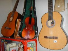 A Dulcet classical guitar, an 'El Primo' guitar, a practice amp and a Lark cased violin.