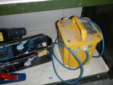 A good collection of work shop tools including angle grinder and a 110 volt converter.