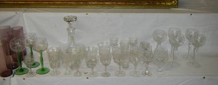A modern decanter and various drinking glasses.