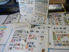 6 albums of world stamps including Victorian.