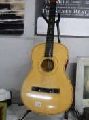 A six string acoustic guitar.