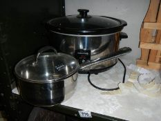 A Morphy Richards slow cooker and a Royal Doulton stainless steel pan.