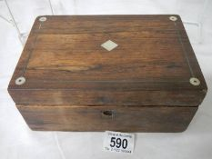 A rosewood tea caddy (crack to one lid).