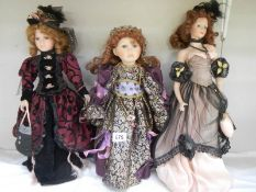 3 good collector's porcelain dolls.
