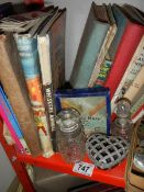 A mixed lot of 1950's hard back books, 1970's annuals, Queen Mary ocean liner game etc.