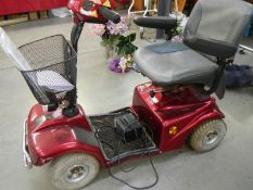 A Rascal four wheel mobility scooter, need new battery and a good clean.
