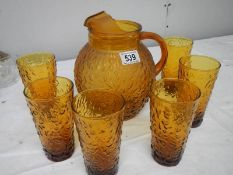 An amber coloured mid 20th century glass lemonade set.