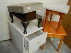 2 stools, a small side table and a white painted chest.