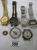 A quantity of old wrist watches and 2 compasses.