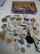 A mixed lot of jewellery including necklaces, brooches, earrings etc. (Approximately 40 items).