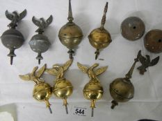 A quantity of 19/20th century brass grandfather clock hood finials including 3 new reproduction