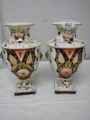 A pair of Crown Derby style vases (heavily restored).