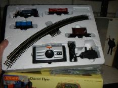 A Hornby OO gauge trains set including track mat, rail track, power unit and locomotive.
