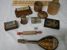 A mixed lot including match holder, perpetual calendar, thermometer, etc.