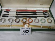 A boxed vintage Titoni Coloursdope 9 ladies wrist watch with 9 interchangable head covers (missing
