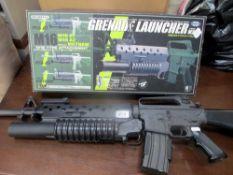 A Tokyo Marui M16 A1-M203 grenade launcher, magazine holder,