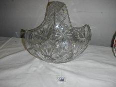 A large cut glass basket, 30cm wide x 27cm tall.