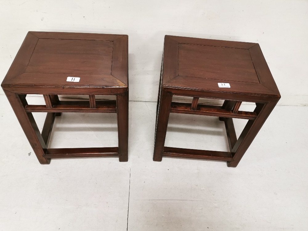 Lot 11 - Pair of Chinese low rectangular lamp tables in square supports with stretchers, 18insH x 15ins x