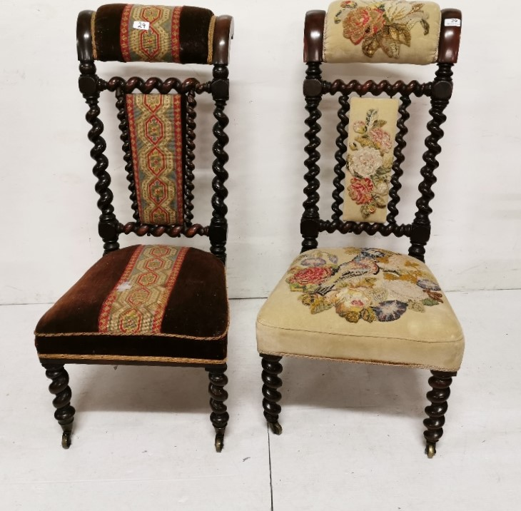 Lot 29 - A similar pair of Victorian rosewood framed Prie Dieu Chairs, one with a parrot needlepoint pattern,